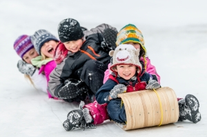 Children Sledding on Toboggan Hill