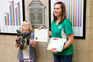 "Director of the Big Horn Basin Foundation, Jessica Lippincott, awards Kaitlin with her ""Kids' Dig Day"" certificate."
