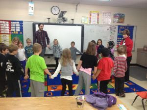 Senor' Rodriquez leads the students in a Spanish song and dance activity.