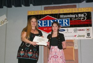 Excellence in Science Award. Brooklyn Wistisen, Excel Academy. Awarded by Carla Martin, Casper Energy Laboratories.