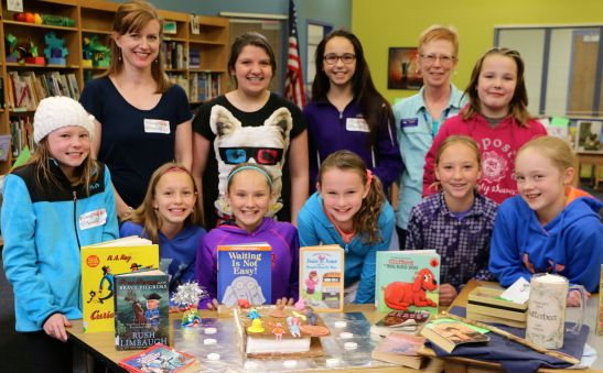 Bookalicious group members with Verda James Library Media Tech, Sue Heisner and Sarah Mailloux, parent volunteer.