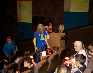 Teachers and Staff hand out popcorn and soda to the students prior to the start of the movie.